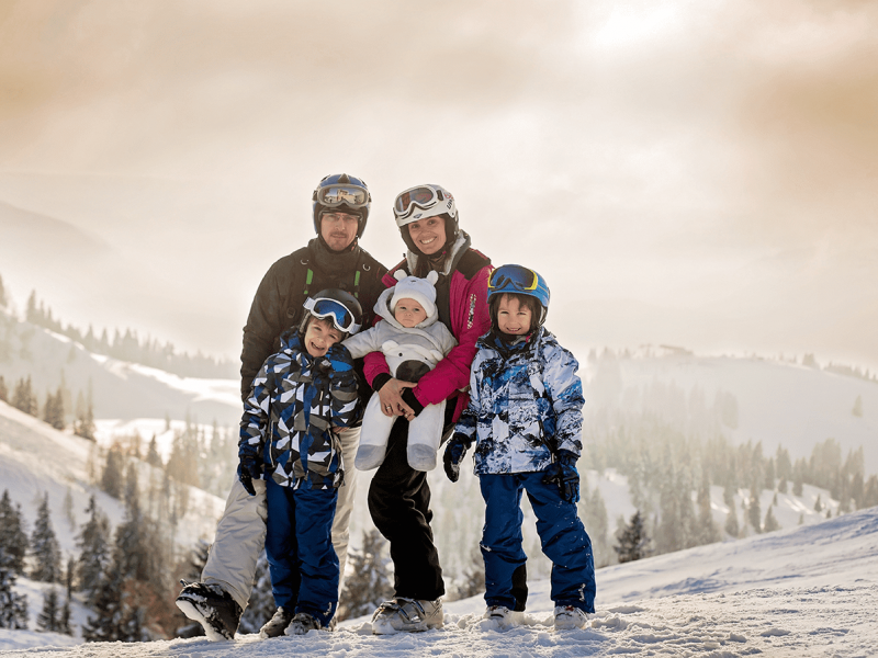 Young family skiing